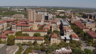 DX0002_107_046 - 5.7K stock footage aerial video of slowly passing campus buildings at the University of Texas, Austin, Texas