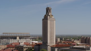 DX0002_108_001 - 5.7K stock footage aerial video close orbit of UT Tower at the University of Texas, Austin, Texas
