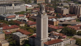 DX0002_108_003 - 5.7K stock footage aerial video ascend and circle the UT Tower at the University of Texas, Austin, Texas