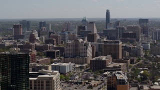 DX0002_108_006 - 5.7K stock footage aerial video descend and fly away from capitol, office buildings and city skyline in Downtown Austin, Texas