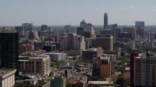 DX0002_108_009 - 5.7K stock footage aerial video ascend to reveal and approach the capitol, office buildings, city skyline in Downtown Austin, Texas