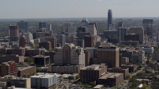 DX0002_108_010 - 5.7K stock footage aerial video of passing the capitol and office buildings, and city skyline in Downtown Austin, Texas