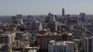 DX0002_108_012 - 5.7K stock footage aerial video of passing the capitol and office buildings, and city skyline in Downtown Austin, Texas