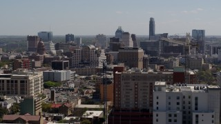 DX0002_108_013 - 5.7K stock footage aerial video slowly passing the capitol and office buildings, and city skyline in Downtown Austin, Texas