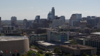 DX0002_108_016 - 5.7K stock footage aerial video ascend and approach the city's skyline in Downtown Austin, Texas