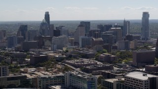 DX0002_108_020 - 5.7K stock footage aerial video of slowly flying away from the city's skyline in Downtown Austin, Texas