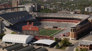 DX0002_108_023 - 5.7K stock footage aerial video of a view of the empty football stadium at the University of Texas, Austin, Texas