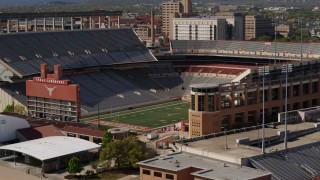 DX0002_108_024 - 5.7K stock footage aerial video of the empty football stadium at the University of Texas, Austin, Texas