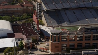 DX0002_108_027 - 5.7K stock footage aerial video orbit scoreboard at the empty football stadium at the University of Texas, Austin, Texas