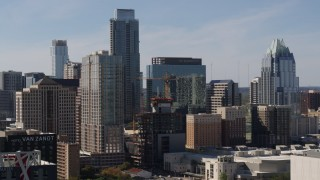 DX0002_108_030 - 5.7K stock footage aerial video flyby city skyscrapers to focus on The Austonian and high-rise hotel in Downtown Austin, Texas