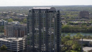 DX0002_108_034 - 5.7K stock footage aerial video of orbiting a high-rise apartment building in Downtown Austin, Texas