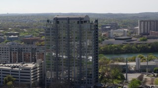 DX0002_108_035 - 5.7K stock footage aerial video of slowly orbiting a high-rise apartment building in Downtown Austin, Texas