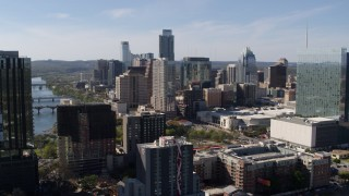 DX0002_108_041 - 5.7K stock footage aerial video of a view of the towering city skyline while ascending in Downtown Austin, Texas