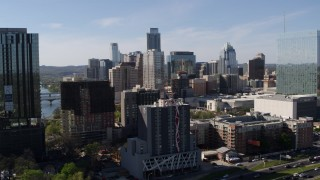 DX0002_108_043 - 5.7K stock footage aerial video of towering city skyline while flying between high-rise and hotel in Downtown Austin, Texas