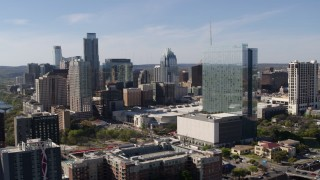 DX0002_108_048 - 5.7K stock footage aerial video ascend to focus on hotel and the city's skyline in Downtown Austin, Texas