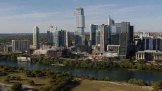 DX0002_109_007 - 5.7K stock footage aerial video modern skyscraper on the other side of Lady Bird Lake, Downtown Austin, Texas