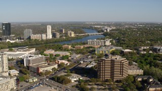 DX0002_109_009 - 5.7K stock footage aerial video a freeway bridge spanning Lady Bird Lake, descend near office building, Austin, Texas