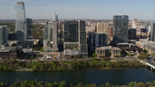 DX0002_109_010 - 5.7K stock footage aerial video of The Northshore skyscraper on the other side of Lady Bird Lake, Downtown Austin, Texas