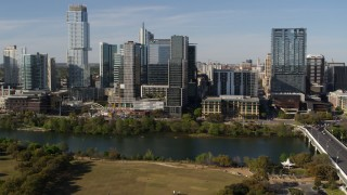 DX0002_109_011 - 5.7K stock footage aerial video flyby and away from The Northshore skyscraper on the other side of Lady Bird Lake, Downtown Austin, Texas