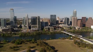 DX0002_109_014 - 5.7K stock footage aerial video of the city's waterfront skyline on the other side of Lady Bird Lake, Downtown Austin, Texas