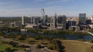 DX0002_109_016 - 5.7K stock footage aerial video of skyscrapers in the city's waterfront skyline on the other side of Lady Bird Lake, Downtown Austin, Texas