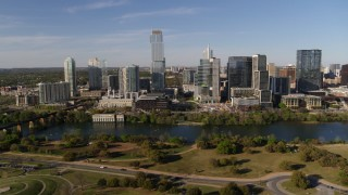 DX0002_109_017 - 5.7K stock footage aerial video of tall skyscrapers in the city's waterfront skyline across Lady Bird Lake, Downtown Austin, Texas