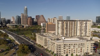 DX0002_109_019 - 5.7K stock footage aerial video of the city's waterfront skyline seen from apartment building and hotel, Austin, Texas