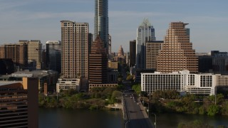 DX0002_109_029 - 5.7K stock footage aerial video of the Texas State Capitol seen between skyscrapers in Downtown Austin, Texas