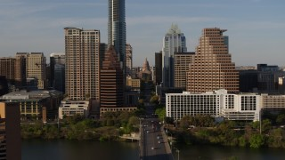 DX0002_109_030 - 5.7K stock footage aerial video of revealing the Texas State Capitol seen between skyscrapers in Downtown Austin, Texas