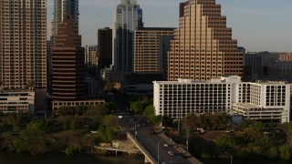 DX0002_109_037 - 5.7K stock footage aerial video of downtown skyscrapers during descent, reveal bridge in Downtown Austin, Texas
