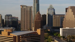 DX0002_109_040 - 5.7K stock footage aerial video of downtown skyscrapers seen during ascent in Downtown Austin, Texas