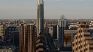 DX0002_109_042 - 5.7K stock footage aerial video fly between downtown skyscrapers, reveal Texas State Capitol in Downtown Austin, Texas
