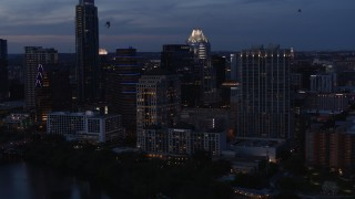 DX0002_110_041 - 5.7K stock footage aerial video fly away from, then approach, San Jacinto Center at twilight in Downtown Austin, Texas