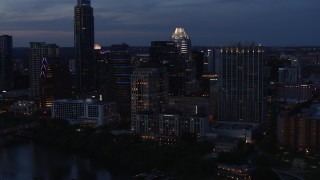 DX0002_110_042 - 5.7K stock footage aerial video fly away from San Jacinto Center at twilight in Downtown Austin, Texas