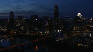 DX0002_111_003 - 5.7K stock footage aerial video approach Austonian and waterfront skyline from Lady Bird Lake at twilight in Downtown Austin, Texas