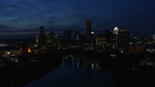 DX0002_111_008 - 5.7K stock footage aerial video slowly flyby waterfront skyline on the shore of Lady Bird Lake at twilight in Downtown Austin, Texas