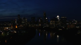 DX0002_111_012 - 5.7K stock footage aerial video city's waterfront skyline on the opposite shore of Lady Bird Lake at night in Downtown Austin, Texas