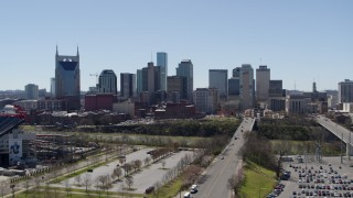 DX0002_112_001 - 5.7K stock footage aerial video ascend for view of city's skyline near the river in Downtown Nashville, Tennessee
