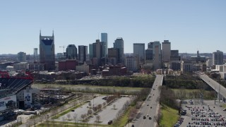 DX0002_112_002 - 5.7K stock footage aerial video a reverse view of city's skyline near the river in Downtown Nashville, Tennessee