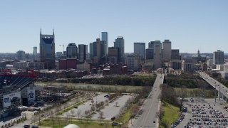 DX0002_112_003 - 5.7K stock footage aerial video approaching the city's skyline near the river in Downtown Nashville, Tennessee