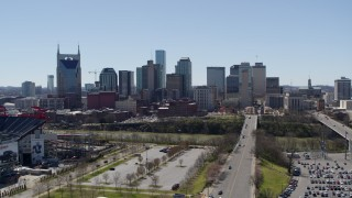DX0002_112_004 - 5.7K stock footage aerial video approaching the city's skyline near the river during ascent in Downtown Nashville, Tennessee