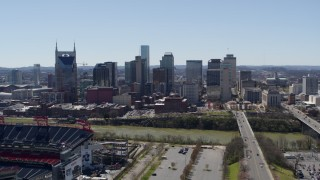 DX0002_112_007 - 5.7K stock footage aerial video of the city's skyline seen while ascending near football stadium in Downtown Nashville, Tennessee