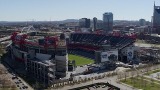 DX0002_112_010 - 5.7K stock footage aerial video of orbiting the football stadium with view of the field in Nashville, Tennessee