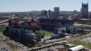 DX0002_112_011 - 5.7K stock footage aerial video of an orbit of the football stadium with view of the field in Nashville, Tennessee