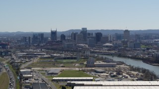 DX0002_112_015 - 5.7K stock footage aerial video a wide view of the city's skyline and river seen from warehouse buildings in Downtown Nashville, Tennessee