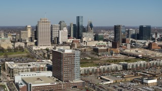 DX0002_113_018 - 5.7K stock footage aerial video flyby city's skyline behind apartment complexes and office buildings in Downtown Nashville, Tennessee
