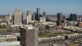 DX0002_113_022 - 5.7K stock footage aerial video flyby office and apartment buildings, ascend for view of skyline in Downtown Nashville, Tennessee