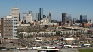 DX0002_113_024 - 5.7K stock footage aerial video reverse view of office building, skyline in background, Downtown Nashville, Tennessee