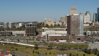 DX0002_113_028 - 5.7K stock footage aerial video of descending by office buildings in Nashville, Tennessee