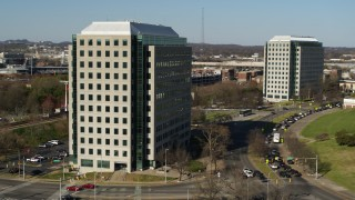 DX0002_113_045 - 5.7K stock footage aerial video of orbiting a government office building to reveal a second building in Downtown Nashville, Tennessee